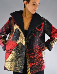 Reds and Creme Collage coat.. Medium sized Overlapping fronts.  Collaged fabrics quilted  free hand long arm machine. SOLD