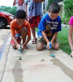 use squirt guns to race cars across the patio A Water Themed Birthday Party