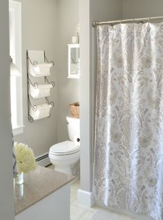 White, gray and taupe. This subtle color palette creates an elegant, sophisticated bathroom. Walls here are painted in Spacious Gray SW (Favorite Paint Gray) Grey Bathroom Paint, Grey Bathrooms, Small Bathroom, Bathroom Ideas, White Bathroom, Guys Bathroom, Parisian Bathroom, Shower Bathroom, Bathroom Remodeling
