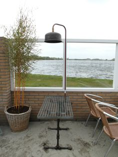Stoere tafel met lamp. Frame  gemaakt van oude fittingen, blad van dejorooster en de lamp van een oud expansievat Outdoor Tables, Outdoor Decor, Outdoor Furniture, Home Decor, Decoration Home, Room Decor, Interior Decorating, Outdoor Furniture Sets