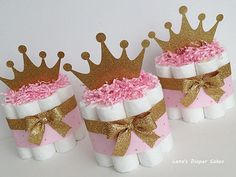 This is listing For 3 Tier Pink & Gold Little Princess Diaper Cake Ingredients: * 62 - Pampers Swaddlers (size 1-2) * 100% usable diapers * High quality ribbons * The cake Measurements approximately: 10W X 16H * The Crown topper will ship in the side, It comes attached to a thin
