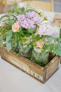DIY rustic wedding wooden centerpiece boxes. 3 mason jars fit in each box. Table numbers have been painted on both sides of boxes. 15 boxes available.