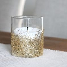 In just 30 seconds, you can add a little sparkle to your home or party decor with this easy glitter votive tutorial.
