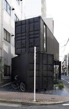 Three containers stacked, used as a place of business, but configuration could be translated into a tiny house.  387 Sq. Ft. Modern Stacked Shipping Containers Photo