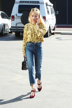 Golden yellow and red: the color combo of fall. Emma Roberts looks so great in her casual yet polished look.