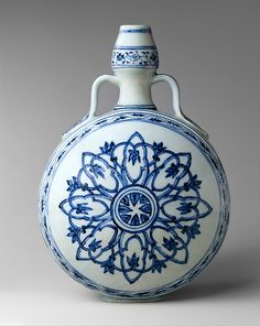 Flask with Medallion Period: Ming dynasty (1368–1644) Date: early 15th century Culture: China Medium: Porcelain painted with cobalt blue under transparent glaze (Jingdezhen ware) Dimensions: H. 12 1/4 in. (31.1 cm) Classification: Ceramics