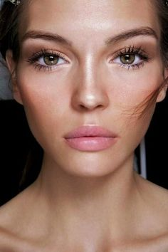 You can achieve this beautiful look with this steps: – moisturize the skin and leave it as natural as posibble- on the eye lids use white (on the inner corner) and well-blended pearly brown (on the outer corner and the crease) – finish the eyes with mascara on the upper and the lower lashes – contour the cheeks with a peachy blush, and the most important: highlight the brightest parts of your face (the nose, the center of the forehead and the cupid's bow) – use a light pink lipstick