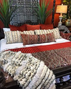 More IS more - you ain't foolin' us! Antique Indian bed positively piled with Moroccan textile goodness!