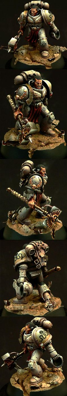 A deceptively simple Space Marine Captain given an amazing paint job with great light effects and design.