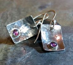 Sweet raspberry pink rhodolite garnet on hammered sterling.  A shiny little something for your ears!     ...from Lavender Cottage on Etsy