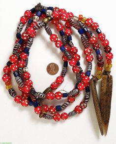 Skunk Red Feather vénitien bleu verre commerce par africadirect