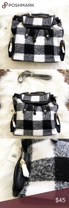 White Buffalo Plaid Vegan Leather Backpack Purse Brand New with Tags! Wool & Vegan Leather.  White & Black Buffalo Plaid. (This is the same as the red buffalo plaid backpack I have listed) Super Soft.  Has extra strap to be worn as messenger bag. Chevron Print inside with extra pockets ♥️ Magnetic button flap & drawstring closure Wool and faux leather trim Front & side zipper pockets Inside lining with open/zipper pockets 37 inch back adjustable straps 54.5 inch extra adjustable strap 10 (W)…