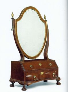 """A Chippendale Mahogany Reverse-Serpentine Dressing Glass, Boston, 1785-1800. Pictured in """"The Magazine Antiques"""" (March 1970), p. 339; Bondome, """"The Home Market: The Box Toilet Mirror"""""""