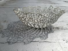 These gorgeous doilies are not cloth. These gorgeous porcelain sculptures are made by dipping a crocheted doily into liquid porcelain, and they are fired in a kiln. the result is fiber free, the crochet burns out in the hot kiln.gorgeous delicate piece of art. such a simple idea, creating impactful art.