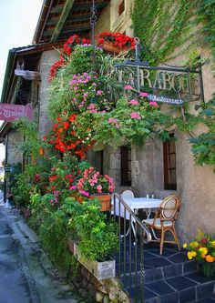 Flowers help enhance the exterior of this little bistro