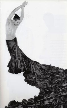 Joaquín Cortés, the best (professional) Flamenco dancer I have seen! He came out in only a long skirt (not like this more a black flowing maxi skirt) and high heeled flamenco shoes....only HE could, I'm guessing!