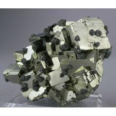 Pyrite from Huanzala Mine, Huanuco Dept., Peru -- A brilliant group of striated Pyrite cubes adorned with numerous rounded crystal groups of Sphalerite.