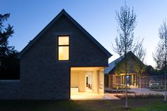 Using the same stone and combining it with timber shading and large panels of high performance glass, the new space blends perfectly with the surroundings. #architecture #england #glazing #rural #extension #cantifix
