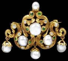 Brooch of gold set with freshwater pearls, diamonds and demantoid garnets, made in the USA, about 1900.