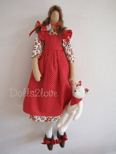 Tilda doll Isabelle wearing a dress with a print of by Dolls2love