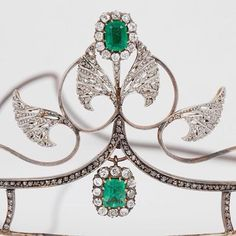 a close up of the central motif from the David Andersen tiara