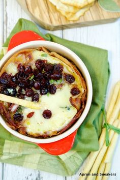 bacon-wrapped baked brie with port wine cranberry sauce