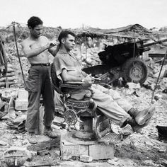 outdoor vintage barbershop -- WWII?