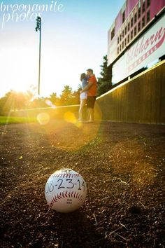 Baseball engagement pictures.
