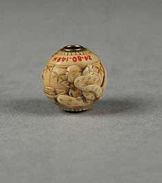 Carved bead Date: 19th century Culture: Japan Medium: Ivory Dimensions: H. 3/8 in. (1 cm); W. 3/8 in. (1 cm) Classification: Ojime
