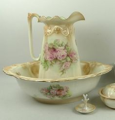 Staffordshire pottery toilet set decorated with roses.