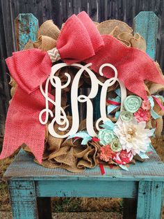 Coral and mint monogrammed burlap wreath.www.peaceloveburlap.etsy.com