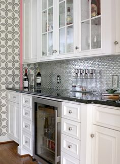 Custom Designed Bar Area | Designers Guild wallpaper | Mirrored glass tile | Black diamond granite countertop