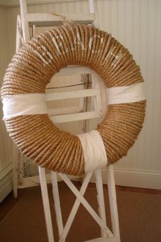 This would look great on a beachy porch - Buy a cheap wreath, wrap with rope , wrap with fabric and stencil the words BEACH on it, found on Domestically Speaking.