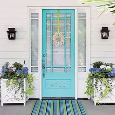 aqua screen door with house numbers