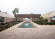 Swiss architect Valerio Olgiati added concrete fins to the walls of this house in Portugal, which splay like the flaps of an open box to shade a garden
