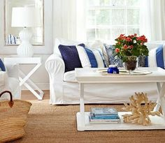 Coastal living room with white decor and a skirted sofa
