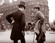 Two Gentlemen, London, 1904  The blurring of the carriage on the street suggests that the photographer used a tripod for his camera, yet somehow escaped notice for this candid shot.