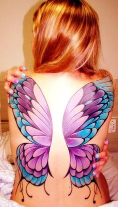I like the colors, but it looks more like wings placed on her back, not wings on her back. If you know what I mean...