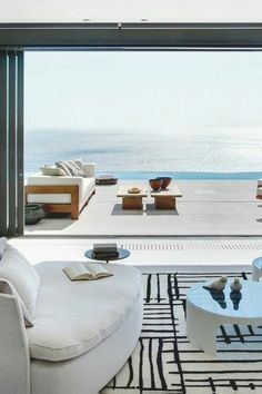 Interior Design, white #sofas, black and white rug, patio #furniture, heavenly ocean view. Right at #home