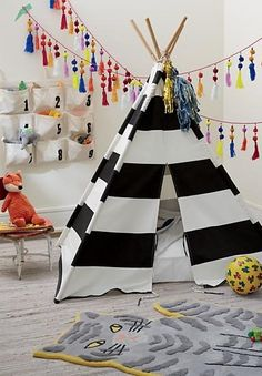 Our black and white striped teepee is the perfect home away from home while your kids are trailblazing the playroom frontier. They'll love having a hideout tent to use as a fort, reading nook, or whatever else their imagination can dream up. Not to mention, our kids teepees are just too cute and make a perfect statement piece in a kids bedroom or playroom!