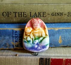 Check out this item in my Etsy shop https://www.etsy.com/listing/455925052/rainbow-ceramic-porcelain-buddha-pendant