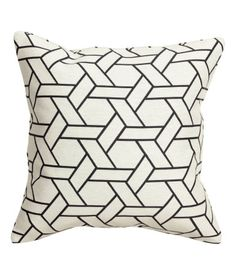 Jacquard-weave cushion cover with a concealed zip.