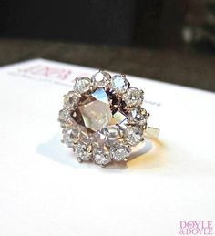 The color of that diamond! Antique fancy brown Old European cut diamond cluster ring, from Doyle & Doyle.