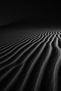 Desert ripples on a dune at night in the United Arab Emirates, by Daniel Nahabedian