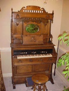 """Restored Oak Victorian pump organ. Ornate carving, pump organ w/stool. Made in Chicago by Beck. Measures 78""""tall x 44""""wide x 24""""deep."""