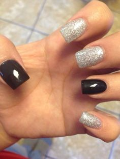 Two solid black and threes silver glitter nails!!! GENIUS lol love them!
