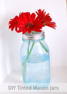 DIY Blue Mason Jars from Linda at Craftaholics Anonymous. a great way to permanently tint your mason jars for that vintage look. so beautiful & easy to do! Tinted Mason Jars, Mason Jar Vases, Blue Mason Jars, Mason Jar Flowers, Bottles And Jars, Mason Jar Crafts, Diy Flowers, Glass Jars, Flower Jars