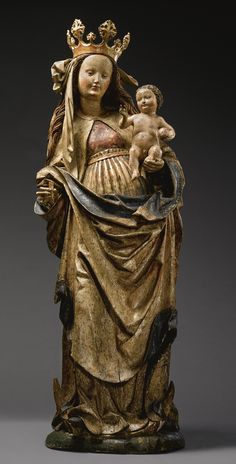 A lifesize South German gilt and painted lindenwood group of the Madonna and Child, from the circle of Hans Multscher (1400- before 1467), circa 1480
