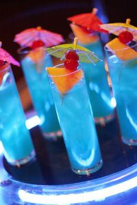 Blue Breeze  (2 ounces Hpnotiq liqueur    1 ounce super premium coconut rum      Splash of pineapple juice)