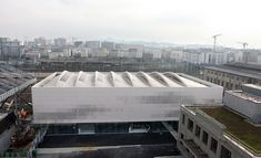 Completed in 2012 in Paris, France. The Pajol Sports Centre is a new facility in the arrondissement of Paris. Arranged over three levels, the building is formed of two opaque. Gymnasium Architecture, Architecture Design, Roof Design, Facade Design, Centro Fitness, Sport Hall, Roof Structure, Paris Ville, Roof Light